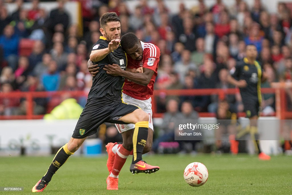 Robert Brady of Norwich and Mustapha Carayol of Nottingham Forest in action during the Sky Bet Championship match between Nottingham Forest and Norwich City at the City Ground on September 17, 2016 in Nottingham, England.
