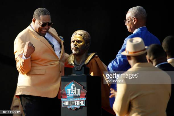 Robert Brazile reacts at the unveiling of his bust during the 2018 NFL Hall of Fame Enshrinement Ceremony at Tom Benson Hall of Fame Stadium on...