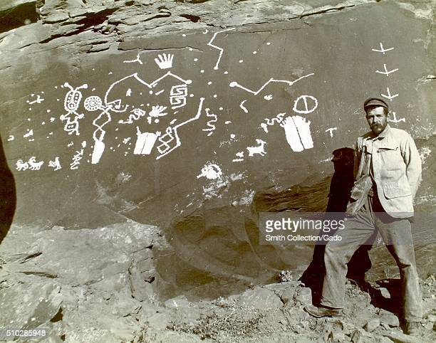 Robert Brewster Stanton a civil and mining engineer posing with ancient petroglyphs in Glen Canyon Colorado River 1893 From the New York Public...