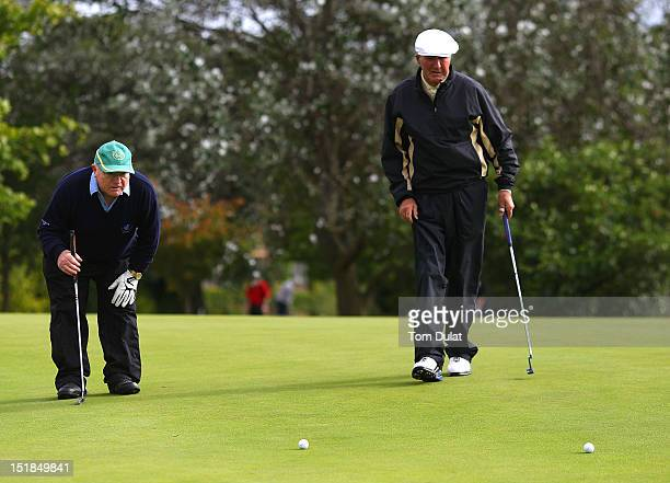 Robert Brown and Thomas Weir of Laytown Bettystown Golf Club line up a putt on the 9th green during the PGA Super 60's Tournament at the De Vere...