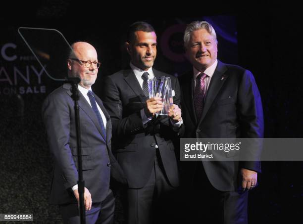 Robert Burke Designer Alexandre Birman and President CEO of FFANY Ron Fromm speak onstage at the Annual QVC presents 'FFANY Shoes On Sale' Gala at...
