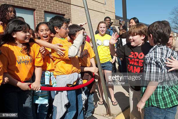 """Robert Capron and Zachary Gordon greet students during the premiere of """"Diary Of A Wimpy Kid"""" at on March 18, 2010 in Alexandria, Virginia."""