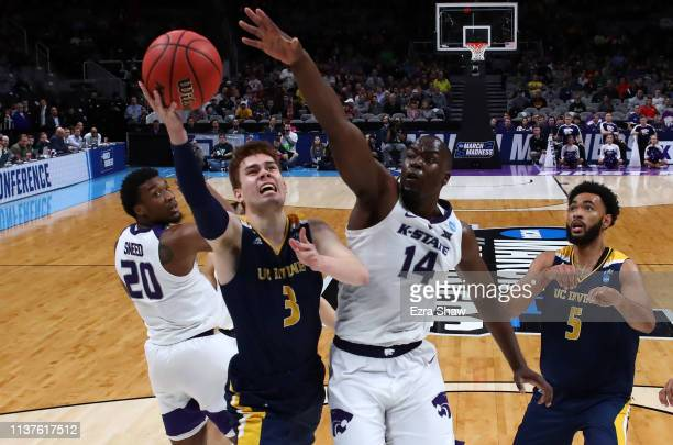 Robert Cartwright of the UC Irvine Anteaters takes a shot against Makol Mawien of the Kansas State Wildcats in the second half during the first round...