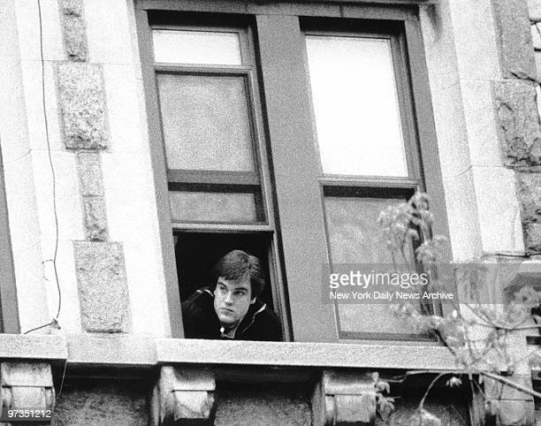 Robert Chambers Jr peering out of a window at Incarnation Rectory where his is residing while on bail Chambers will soon be going to trial for the...