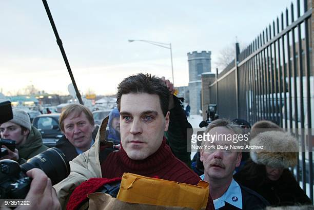Robert Chambers wearing a red sweater on a chilly Valentine's Day and clutching a paper bag brushes past reporters and cameras upon his release from...