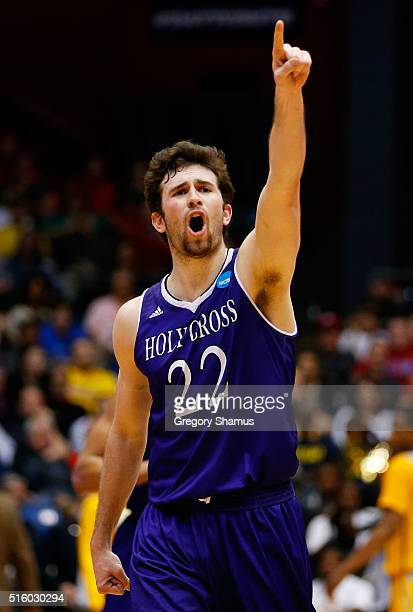 Robert Champion of the Holy Cross Crusaders celebrates after they defeated the Southern University Jaguars 59 to 55 during the first round of the...