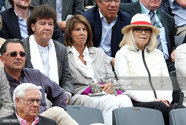 Robert Charlebois his wife Laurence Charlebois and Mireille Darc attend Day 10 of the French Open 2014 held at RolandGarros stadium on June 3 2014 in...