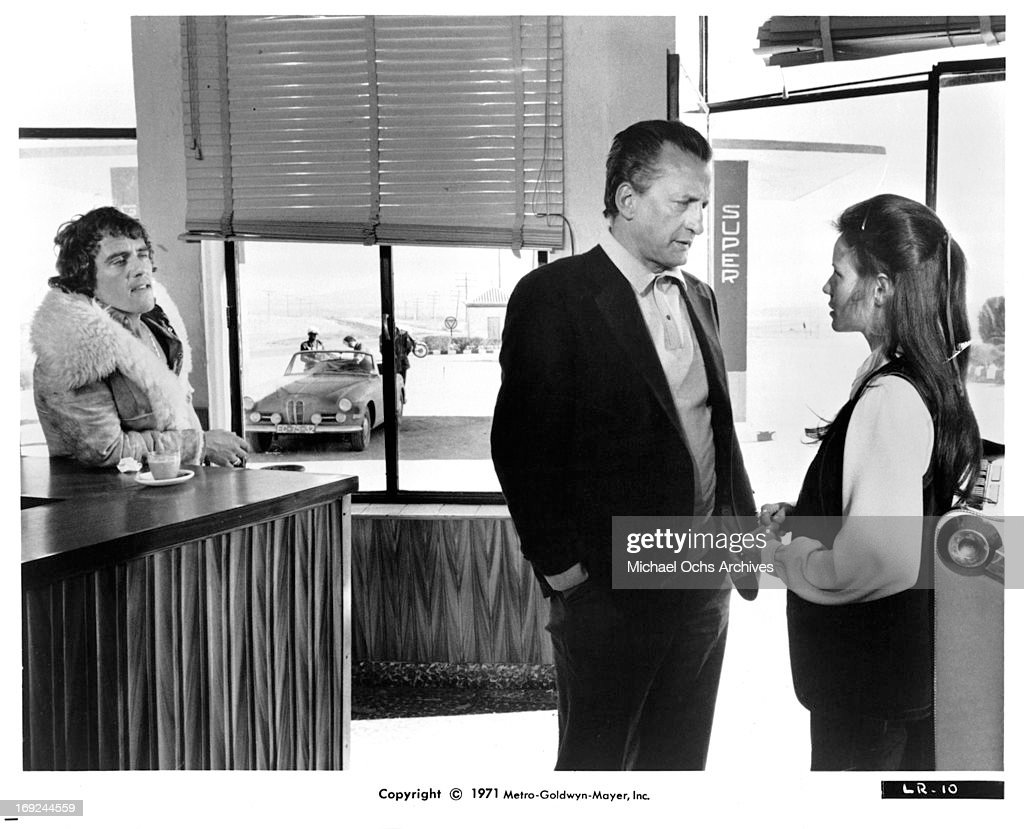 Robert Coleby watches as George C Scott talks with Trish Van Devere in a scene from the film 'The Last Run' 1971
