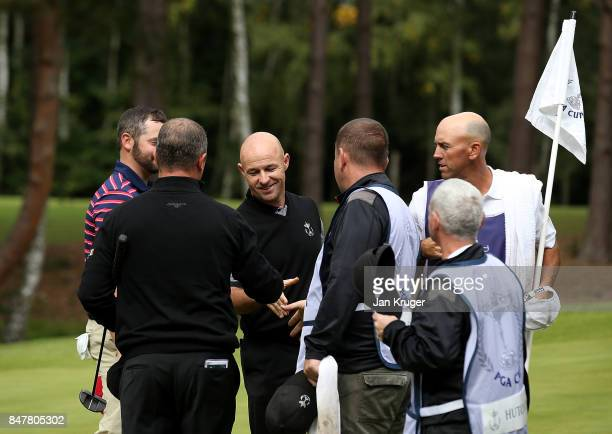 Robert Coles of the Great Britain and Ireland PGA Cup team celebrates winning a point with team mate Greig Hutcheon during the morning fourball...
