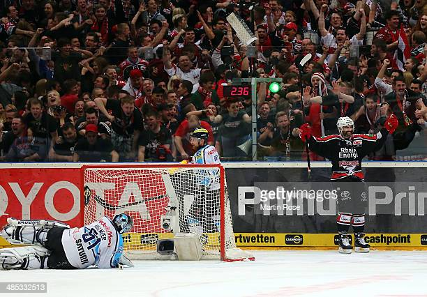 Robert Collins of Koeln celebrate after scoring in game one of the DEL final playoffs between Koelner Haie and ERC Ingolstadt at Lanxess Arena on...