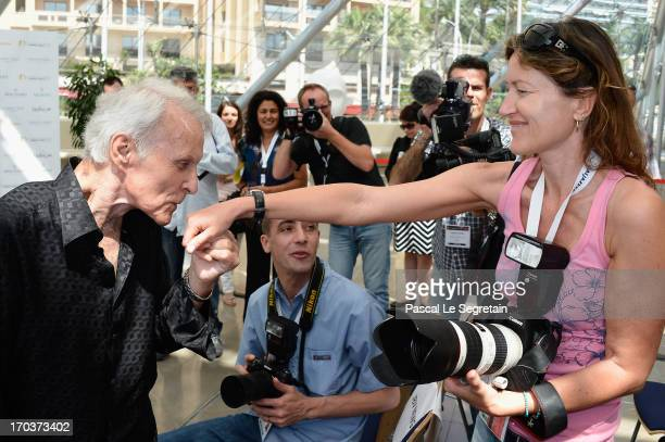 Robert Conrad kisses the hand of photographer Murielle Grander Cransac at a photocall during the 53rd Monte Carlo TV Festival on June 12 2013 in...