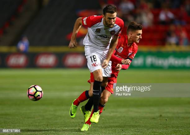Robert Cornthwaite of the Wanderers and Jordan O'Doherty of Adelaide contest for the ball during the round 27 ALeague match between Adelaide United...