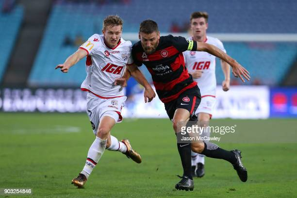 Robert Cornthwaite of the Wanderers and Ryan Kitto of Adelaide compete for the ball during the round 15 ALeague match between the Western Sydney...