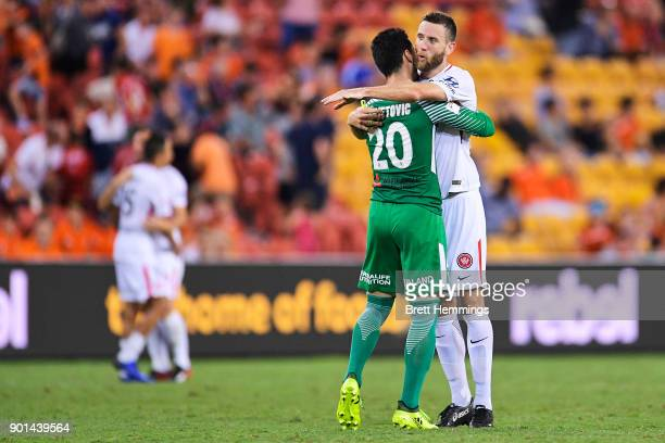 Robert Cornthwaite of the Wanderers celebrates victory with Vedran Janjetovic of the Wanderers during the round 14 ALeague match between the Brisbane...