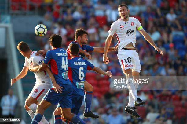 Robert Cornthwaite of the Wanderers contests a header during the round four ALeague match between the Newcastle Jets and the Western Sydney Wanderers...