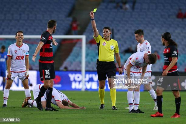 Robert Cornthwaite of the Wanderers receives a yellow card from Referee Shaun Evans during the round 15 ALeague match between the Western Sydney...