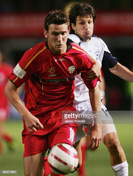 Robert Cornthwaite of United and Vince Lia of Victory in action during the round three ALeague match between Adelaide United and Melbourne Victory at...