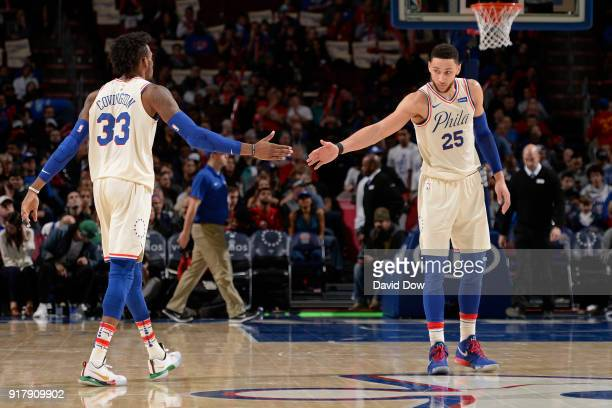 Robert Covington and Ben Simmons of the Philadelphia 76ers shake hands during the game against the New Orleans Pelicans at Wells Fargo Center on...