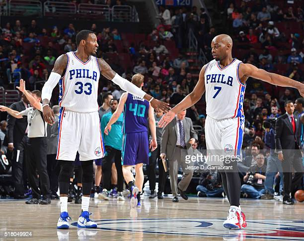 Robert Covington and Carl Landry of the Philadelphia 76ers give each other high fives against the Charlotte Hornets at Wells Fargo Center on March 29...