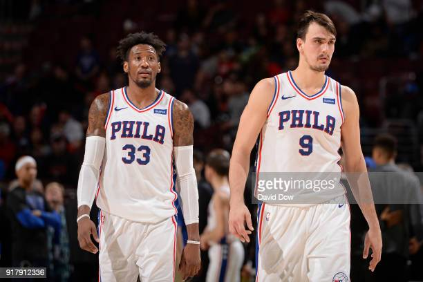 Robert Covington and Dario Saric of the Philadelphia 76ers walk up court during the game against the LA Clippers at Wells Fargo Center on February 10...
