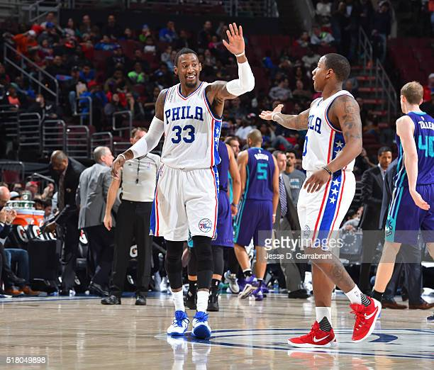 Robert Covington and Isaiah Canaan of the Philadelphia 76ers give each other high fives against the Charlotte Hornets at Wells Fargo Center on March...