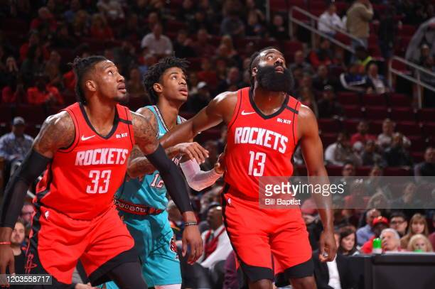 Robert Covington and James Harden of the Houston Rockets play defense against Ja Morant of the Memphis Grizzlies on February 26 2020 at the Toyota...