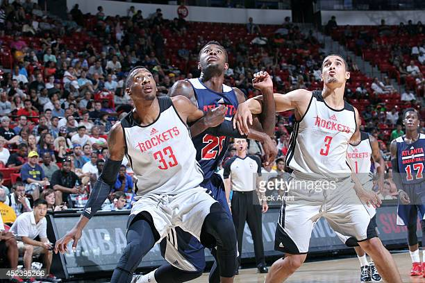 Robert Covington and Robert Covington of the Houston Rockets battle for position against DJ Shelton of the Atlanta Hawks during the Samsung NBA...