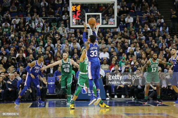 Robert Covington of Philadelphia 76ers in action against Jayson Tatum of Boston Celtics during the NBA game between Boston Celtics and Philadelphia...