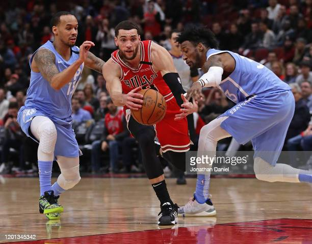 Robert Covington of the Minnesota Timberwolves knocks the ball away from Zach LaVine of the Chicago Bulls as he drives past Shabazz Napier at the...