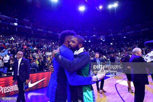 Robert Covington of the Philadelphia 76ers and Kyrie Irving of the Boston Celtics exchange a hug after the game between the two teams on January 11...