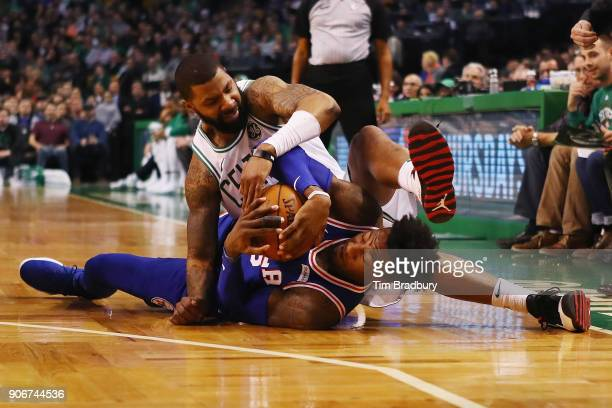 Robert Covington of the Philadelphia 76ers and Marcus Morris of the Boston Celtics battle for a loose ball during the first half of their game at TD...