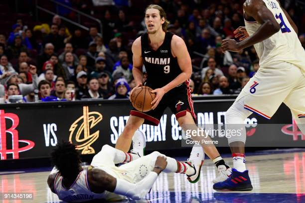 Robert Covington of the Philadelphia 76ers can't get the flop to count as a foul against Kelly Olynyk of the Miami Heat during the fourth quarter at...