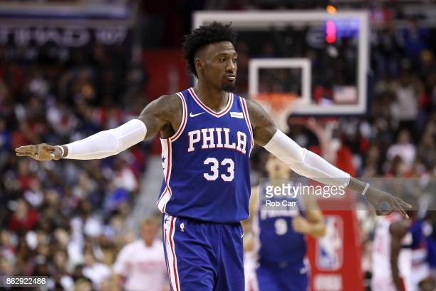 Robert Covington of the Philadelphia 76ers celebrates after scoring against the Washington Wizards at Capital One Arena on October 18 2017 in...