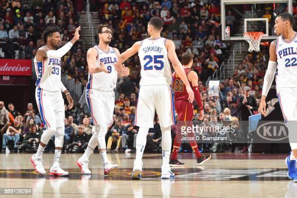 Robert Covington of the Philadelphia 76ers Dario Saric of the Philadelphia 76ers and Ben Simmons of the Philadelphia 76ers high five on the court...