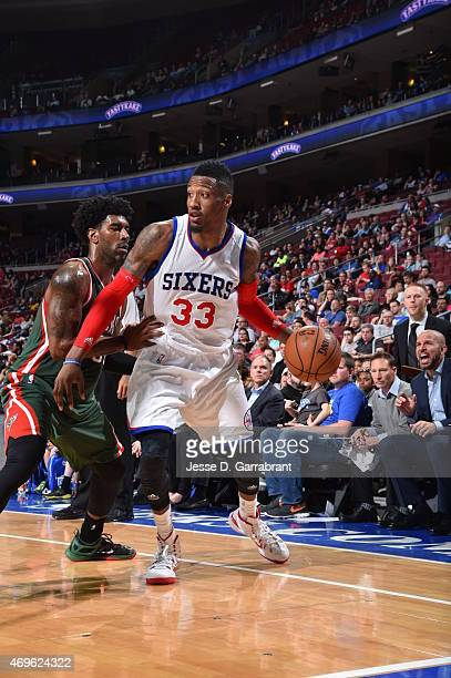 Robert Covington of the Philadelphia 76ers dribbles the ball against the Milwaukee Bucks at Wells Fargo Center on April 13 2015 in Philadelphia...