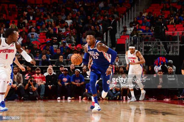 Robert Covington of the Philadelphia 76ers drives against the Detroit Pistons on October 23 2017 at Little Caesars Arena in Detroit Michigan NOTE TO...