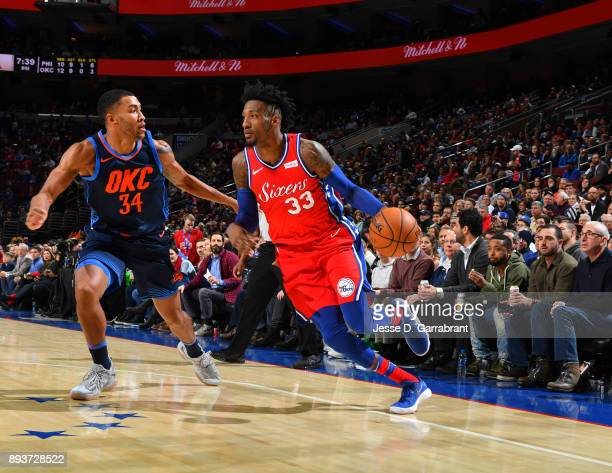 Robert Covington of the Philadelphia 76ers drives baseline against the Oklahoma City Thunder at Wells Fargo Center on December 15 2017 in...
