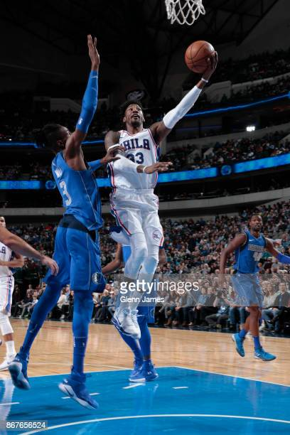Robert Covington of the Philadelphia 76ers drives to the basket against the Dallas Mavericks on October 28 2017 at the American Airlines Center in...