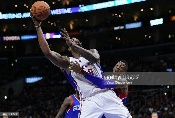 Robert Covington of the Philadelphia 76ers fouls DeAndre Jordan of the Los Angeles Clippers while Jordan is shooting in the second half during the...