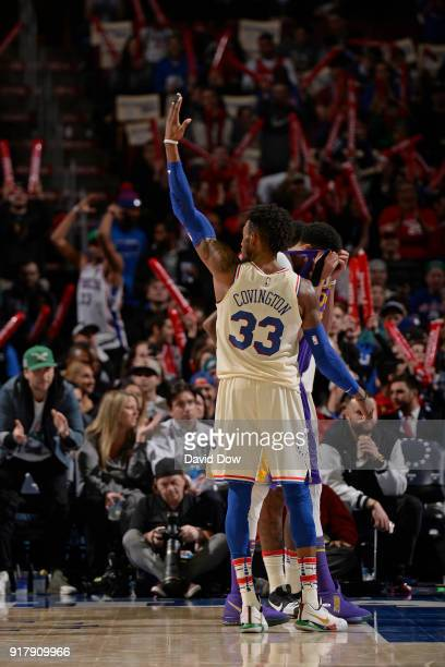 Robert Covington of the Philadelphia 76ers gets the crowd into the game against the New Orleans Pelicans at Wells Fargo Center on February 9 2018 in...