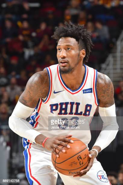 Robert Covington of the Philadelphia 76ers handles the ball against the Cleveland Cavaliers on December 9 2017 at Quicken Loans Arena in Cleveland...