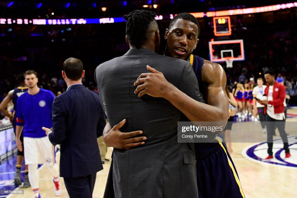 Robert Covington #33 (L) of the Philadelphia 76ers hugs Thaddeus Young #21 of the Indiana Pacers after the game at the Wells Fargo Center on April 10, 2017 in Philadelphia, Pennsylvania. The Pacers won 120-111.