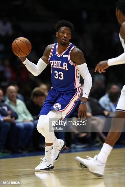 Robert Covington of the Philadelphia 76ers in action against the Brooklyn Nets during their Pre Season game at Nassau Veterans Memorial Coliseum on...