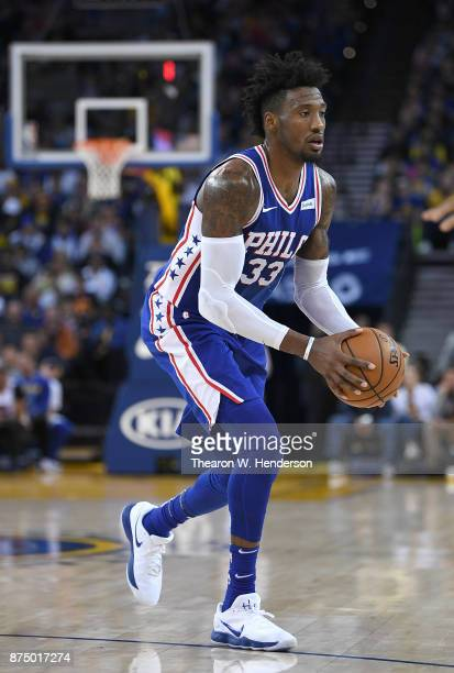 Robert Covington of the Philadelphia 76ers looks to pass the ball against the Golden State Warriors during an NBA basketball game at ORACLE Arena on...