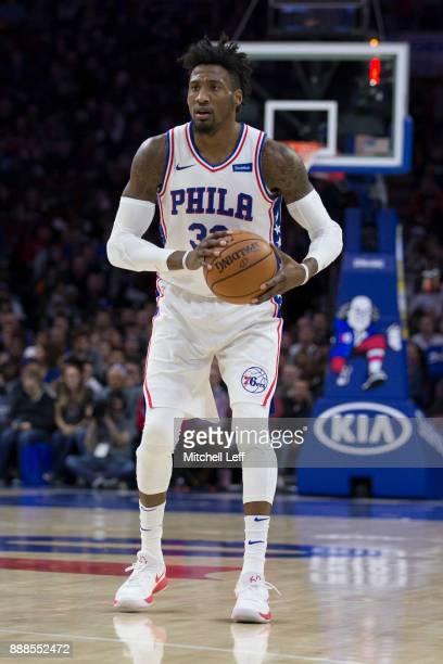 Robert Covington of the Philadelphia 76ers looks to passes the ball against the Detroit Pistons at the Wells Fargo Center on December 2 2017 in...