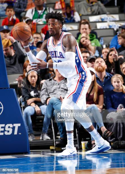 Robert Covington of the Philadelphia 76ers passes the ball against the Dallas Mavericks on October 28 2017 at the American Airlines Center in Dallas...