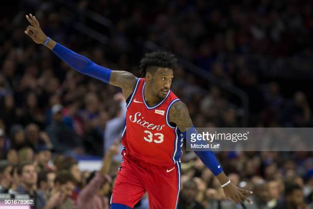 Robert Covington of the Philadelphia 76ers reacts after making a three point basket in the third quarter against the Detroit Pistons at the Wells...