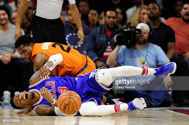 Robert Covington of the Philadelphia 76ers reacts to a collision with Eric Bledsoe of the Phoenix Suns during the third quarter at the Wells Fargo...