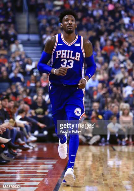 Robert Covington of the Philadelphia 76ers runs down the court during the first half of an NBA game against the Toronto Raptors at Air Canada Centre...