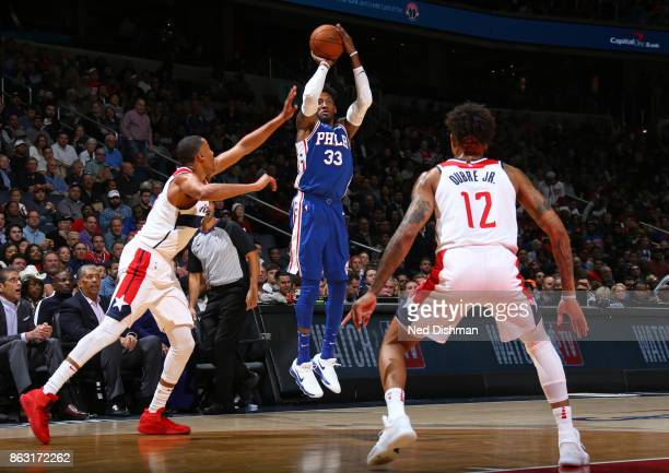 Robert Covington of the Philadelphia 76ers shoots the ball against the Washington Wizards on October 18 2017 at Capital One Arena in Washington DC...